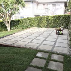 Large pavers used to create patio in backyard. Quick and easy alternative to building a full deck.