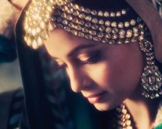 A tikka is a common ornament in Desi bridal wear. Here are some different ways the jewelry can be worn into a hairstyle.
