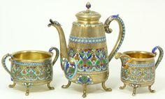 Marius Hammer (1847-1927)Norwegian enameled silver tea set with raised enameled scrolled floral design and figural enameled bird's head spout.