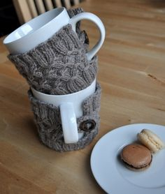 "I love this coffee or tea cup cozy with a button, a little ""sweater"" to help keep warm... sweet! (But how can I make a hat...?) Truly blessed, I made it to adulthood knowing how to knit, crochet, embroider, mend and sew. (""Honey, look what I made for you!"" ""Um..... it's....? Oh thank you, dear......??"")"