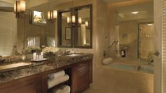 The Ritz-Carlton, Fort Lauderdale - Luxury bathroom with marble countertops, separate shows and tub, and LCD flat screen TV