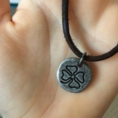 weathered looking rope with a luck pendent (never worn!) life is good brand brown rope chain with silver/worn looking charm Life is Good Jewelry