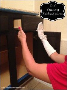 Updated!  {DIY Staining Kitchen Cabinets} A complete makeover staining kitchen cabinets from oak to a rich dark espresso color.  Step by step instructions using a sock and General Finishes stain.