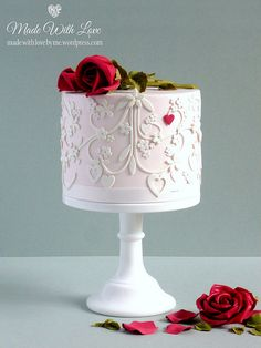 Pretty, detailed cake with a red heart.