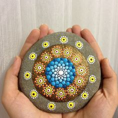 This is a beautifully painted pebble however you look at it...