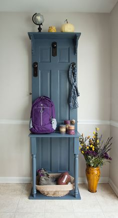 Here's how to turn an old door into an attractive and very useful hall tree. This is a terrific storage solution for coats, boots, hats and more in the entryway or mudroom. It's made from an old panel door with door and cabinet hardware as hooks.