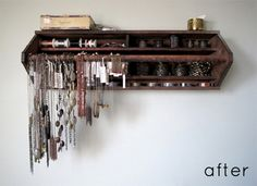 An old wooden tool box turned on it's side and hung up on the wall for storage and display.