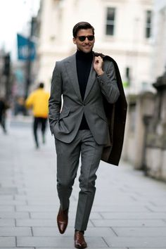 — Black Turtleneck  — Grey Suit  — Black Overcoat  — Brown Leather Oxford Shoes