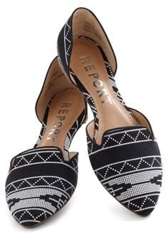 Show off your spunky style in Albuquerque and beyond by touring around in the unique d'Orsay silhouette of these black flats! Whether you travel by foot, scooter, train, or jet, this fabric pair's funky pattern of little white squares will make all you encounter feel festive and fun. With a solid jumpsuit, a tapestry-patterned bag, and a vintage vest, these shoes are destined to look wonderful wherever you roam!