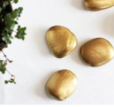 Click pic for 50 St Patricks Day Crafts for Kids - Gold Rocks | Easy Crafts for Kids -- March craft, spray paint rocks for the kids to put in rainbow pots