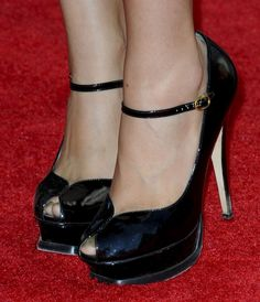 Christian Serratos in Saint Laurent Tribute pumps
