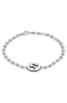 This sterling-silver bracelet features a dainty bauble chain and an interlocking-G charm that remains one of the most iconic symbols of the legendary fashion house. Style Name:Gucci Interlocking-G Bracelet. Style Number: Available in stores. 14k Gold Initial Necklace, Dainty Diamond Necklace, Gold Bar Necklace, Sterling Silver Bracelets, Necklace Set, Silver Earrings, Silver Jewellery, Jewlery, Gucci Bracelet
