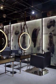 the barber shop located in wuxi, china, which was created by designwire, uses palette of luxurious dark textures, colors and hexagonal shapes.