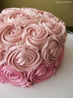 Going to try this for Mother's Day well see how it goes!!!   This would be a pretty mother's day cake Baking with Blondie : White Chocolate Raspberry Frosting