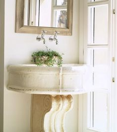 Wall-mount faucet and stone sink; architectural piece hides plumbing