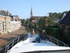 Our rental boat can narrowly cross the little town Wergae in Friesland, the Netherlands