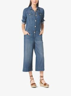 A contemporary take on classic utility style, this denim jumpsuit is designed with a button-front and cropped, wide-leg silhouette. Style it with rolled up sleeves and strappy flat-form sandals to capture the season's West Coast-chic aesthetic.