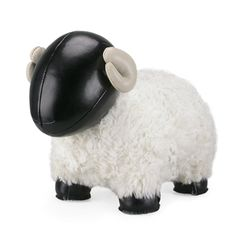 """""""Bomy II Sheep Bookend Black  Zuny Sheep bommi II bookend in tan is a cute heavy-weight that can be used as a doorstop, bookend, paper weight, or to hold up most heavy household items. It is simple, playful and useful in your modern home or as kids room decor. Each Zuny animal is hand-made with care and passion. Made of synthetic leather, fur and iron sand the Zuny bookend weighs 2.2 lbs."""" $56 Fitzsu.com"""