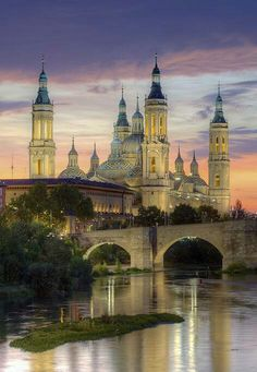 Zaragoza, Spain (Saragossa in English). Is the capital of the Zaragoza Province of Aragon, Spain. It is situated on Ebro River and its tributaries. The building shown in the picture is the Basilica of Our Lady of the Pillars which is a much see! Places Around The World, Oh The Places You'll Go, Places To Travel, Beautiful Places To Visit, Wonderful Places, Amazing Places, Spain And Portugal, Spain Travel, Temples