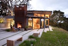 modern home with outdoor fireplace