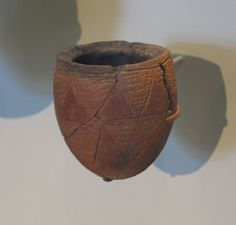 <em>Jar with Impressed and Incised Decoration</em>, ca. 3300-3100 B.C.E. Pottery, painted, 3 3/8 x greatest diam. 1 15/16 in. (8.5 x 5 cm). Brooklyn Museum, Charles Edwin Wilbour Fund, 09.889.446. Creative Commons-BY (Photo: Brooklyn Museum, CUR.09.889.446_erg456.jpg)