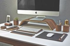 Need something to raise your computer above the fray of your desk? The gorgeous Grovemade Walnut Monitor Stand will do the trick in style.