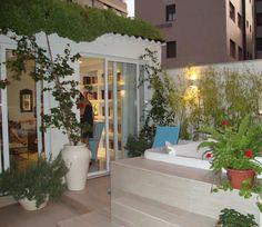 Terraço com jardim, hidromassagem. Ecotelhado© sobre as telhas