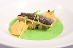 """Sous vide and grilled sea bass fillet on Brussels sprout, foie gras tortellini, pea foam soup & truffle """"caviar"""""""
