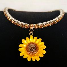 "VTG 1970s Sunflower and Amber Rhinestone Anklet This vintage anklet is in like new condition. It has an enameled metal sunflower dangle with brown rhinestones in the textured center. Ther stretch band is sturdy silver tone metal set with bright amber colored rhinestones all the way around. Perfect for summer and any Boho style. It measures 3"" across unstretched and has plenty of stretch. Vintage Jewelry"