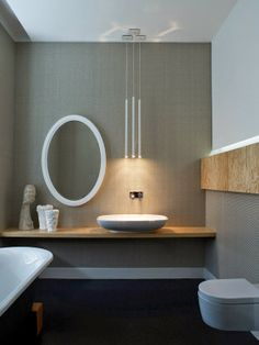 I think the sink looks a bit odd but I like the patterned wallpaper, the hanging lights, and the mix of wood and grey