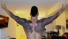 Back and arm tattoo of wings