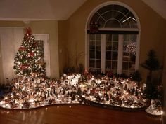 Christmas village display are a beautiful addition to any holiday home. They are often placed beneath the Christmas tree. Christmas Town, Christmas Villages, Noel Christmas, Winter Christmas, Christmas Lights, Christmas Tree Village Display, Lemax Christmas Village, Christmas Mantles, Miniature Christmas