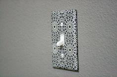 Scrapbook paper + a light switch.