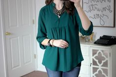 I like how the shape of this Sylvester Split Neck Blouse from Brixon Ivy would hide my belly. this color or any other jewel tone would be fabulous.
