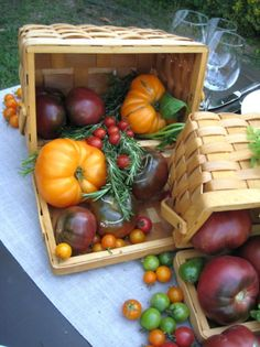Baskets of heirloom tomatoes in all shapes and sizes.