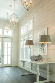 Cottage Entryway with Transom window, Hardwood floors, Pendant light, Crown molding, French doors