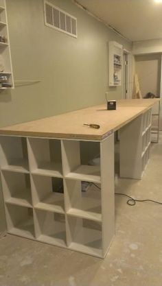 DIY work table... Three 9 cube shelves from lowes Two hollow doors from lowes. This work table is 13' long by jill1.pritchard