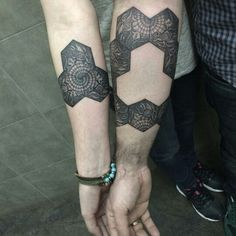 Unique geometric couple tattoo. Also the use of negative space is sublime. Even if u breakup, u still have a killer tattoo