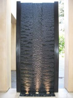 A wall waterfall in dark granite with highlights does make the place look even grand. Apply this idea on one of the exterior walls. #outdoorinteriors