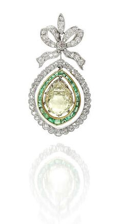 A belle époque emerald and diamond pendant/necklace, circa 1905 The delicate millegrain-set old brilliant and single-cut diamond bow surmount, suspending an articulated drop comprising a pear-shaped briolette diamond, weighing 3.86 carats, within a double border of calibré-cut emeralds and old brilliant and single-cut diamonds, mounted in platinum and yellow gold