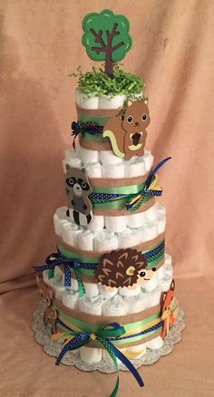 This is a new 4 tier baby shower diaper cake. I can change the ribbon colors to any color you choose, the animal colors I can not change. There is a wooden tree on top, along with a squirrel, a hedgehog, a Deer, Racoon, and Fox. | eBay!