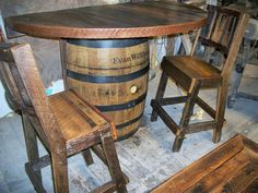 We built this barn wood top for a small bar using half of a barrel and added two bar stools.