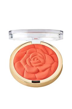 "ELLE.com Beuaty and Fitness Editor Megan O'Neill says, ""Is there anything more cheery and complexion-boosting than a flash of hot coral blush? I suck in my cheeks to make a fish face and tap it gently onto my cheekbones. You don't need an explosion of color, just a slight burnish.-""   Milani Rose Powder Blush in Romantic Rose"