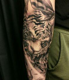 Very impressive tiger tattoo. I love how fierce it looks.