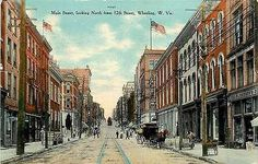 Wheeling West Virginia WV 1908 Downtown Main Street Antique Vintage Postcard Wheeling West Virginia WV 1908 Downtown on Main Street looking North from 12th Street. Used Curteich postcard in good condi
