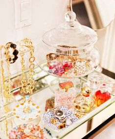 Use glass candy dishes to store your chunky bracelets and rings on your vanity.