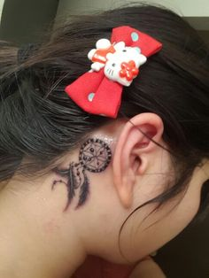 Dreamcatcher behind the ear tattoos