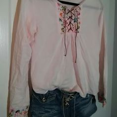 Boho style Lace up 2 piece outfit SO SOFT light weight 100 percent cotton embroidered shirt with front laces and floral embroidery on front and sleeves.  Size Med. Paired with the softest lace up shorts with a bit of STRETCH.  They are both super soft and perfectly worn.  Shorts will fit 10-12 because of the stretch. You receive both items in this order. 1st kiss Shorts Jean Shorts