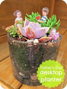Desktop planter  - the blogger printed small pictures of the kids (about 2 inches tall), laminated them so they wouldn't get wet, stuck them on a toothpick and hid those little sweeties among the plants.