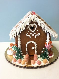 Read all about the history of gingerbread houses (or order supplies and kits) on the Etsy Blog. #DIY